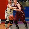 Garber's Halie Schovanec knocks the ball away from Vici's Brenna Morris Thursday February 23, 2017 during the Area playoffs at Chisholm High School. (Billy Hefton / Enid News & Eagle)