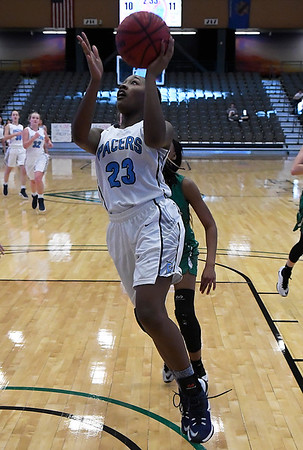 Enid's Johnetta Washington scores a basket against Bishop McGuinness Saturday February 11, 2017 at the Central National Bank Center. (Billy Hefton / Enid News & Eagle)