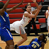 NOC Enid's Alexandra Greenhoward puts up a off balance shot against Eastern's Jasmine Williams and A'Breon Jackson Thursday February 16, 2017 at the NOC Mabee Center. (Billy Hefton / Enid News & Eagle)
