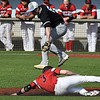NOC Enid's Wade Hanska slides under SE Nebraska's Masen Prooski at second base during the opening game of the season Friday at David Allen Ballpark Friday February 10, 2017. (Billy Hefton / Enid News & Eagle)