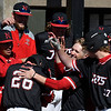 NOC Enid's Carlos Andujar is greeted by team mates as returns to the dugout after hitting a homerun against MCC Longview Saturday February 25, 2017 at David Allen Ballpark. (Billy Hefton / Enid News & Eagle)