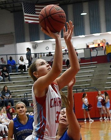 Chisholm's Bailey Brown scores against Hennessey during the district tournament Saturday February 18, 2017 at Chisholm High School. (Billy Hefton / Enid News & Eagle)