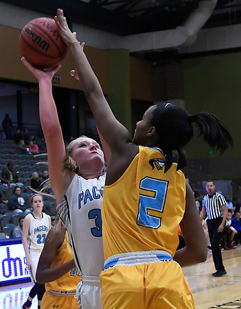 Enid's Sarah Johnson has her shot blocked by Putnam City West's Ce'Nara Skanes Tuesday February 14, 2017 at the Central National Bank Center. (Billy Hefton / Enid News & Eagle)