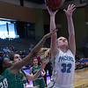 Enid's Sarah Johnson scores a basket against Bishop McGuinness Saturday February 11, 2017 at the Central National Bank Center. (Billy Hefton / Enid News & Eagle)