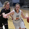 OBA's Elizabeth Price drives toward the basket against Watonga's Claire Gaver Saturday February 4, 2017 during the Downtown Basketball Festival at the Central National Bank Center. (Billy Hefton / Enid News & Eagle)