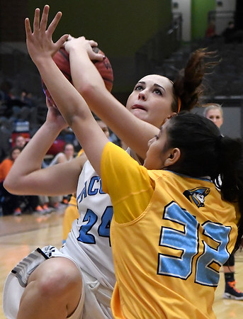 Enid's Izzy Plunkett drives to the basket against Putnam City West's Jocelyn Fernandez Tuesday February 14, 2017 at the Central National Bank Center. (Billy Hefton / Enid News & Eagle)