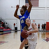 NOC Enid's McKenna Pulley tries to avoid Eastern's Desirea McGinnis Thursday February 16, 2017 at the NOC Mabee Center. (Billy Hefton / Enid News & Eagle)