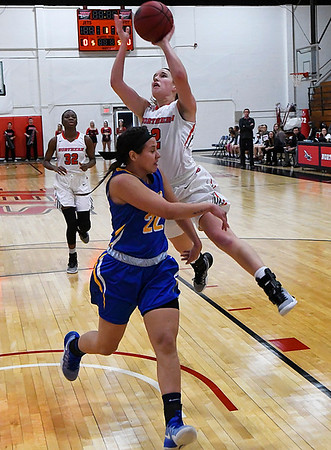 NOC Enid's Sarah Garvie shoots over Northeastern Oklahoma's Maria Delgado Thursday February 23, 2017 at the NOC Mabee Center. (Billy Hefton / Enid News & Eagle)