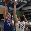 Hennessey's Dalton Vinson shoots over Newkirk's Chaese Hamel Saturday February 4, 2017 during the Downtown Basketball Festival at the Central National Bank Center. (Billy Hefton / Enid News & Eagle)