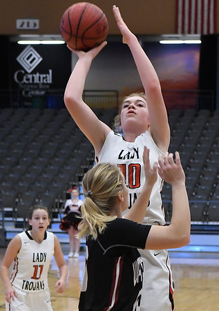 OBA's Elizabeth Price shoots over Watonga's Claire Gaver Saturday February 4, 2017 during the Downtown Basketball Festival at the Central National Bank Center. (Billy Hefton / Enid News & Eagle)
