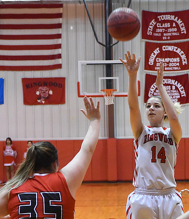 Ringwood's Kamryn Randolph shoots over Cherokee's Morgan Clem Friday February 10, 2017 during the opening round of the district tournament at Ringwood High School. (Billy Hefton / Enid News & Eagle)