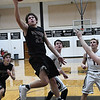 Pioneer's Chris FAw Faw scores against OBA Tuesday February at the OBA gym. (Billy Hefton / Enid News & Eagle)