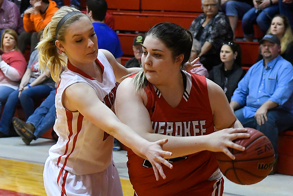 Ringwood's Abigail Anderson pressures Cherokee's Morgan Clem Friday February 10, 2017 during the opening round of the district tournament at Ringwood High School. (Billy Hefton / Enid News & Eagle)