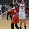 Enid's Izzy Plunkett puts up a three point shot over Lawton's B. Puente Friday February 3, 2017 at the Central National bank Center. (Billy Hefton / Enid News & Eagle)