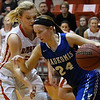 Waukomis' Madie Myers dribbles upcourt against pressure from Ringwood's Abigail Anderson Thursday February 2, 2016 at Ringwood HIgh School. (Billy Hefton / Enid News & Eagle)