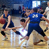 Hennessey's Matthew Smith and Dayton Wymore combine to take the ball away from Newkirk's Colby Case Saturday February 4, 2017 during the Downtown Basketball Festival at the Central National Bank Center. (Billy Hefton / Enid News & Eagle)