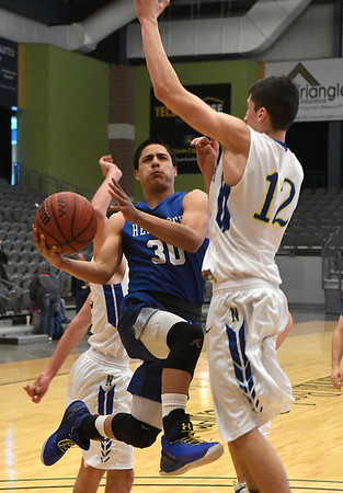 Hennessey's Carlos Rojo goes to the basket against Newkirk's Chaese Hamel Saturday February 4, 2017 during the Downtown Basketball Festival at the Central National Bank Center. (Billy Hefton / Enid News & Eagle)