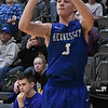 Hennessey's Matthew Smith shoots a three point shot against Newkirk Saturday February 4, 2017 during the Downtown Basketball Festival at the Central National Bank Center. (Billy Hefton / Enid News & Eagle)