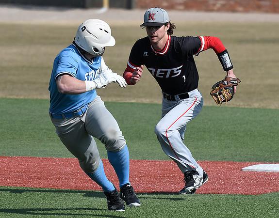 NOC Enid's D.J. Calvert runs down Southeast CC's Brock Olson Friday February 9, 2018 at David Allen Memorial Ballpark. (Billy Hefton / Enid News & Eagle)