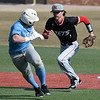 NOC Enid's D.J. Calvert runs down Southeast CC's Brock Olson Friday February 9, 2018 at David Allen Memorial Ballpark. (Billy Hefton / Enid News & Eagle)