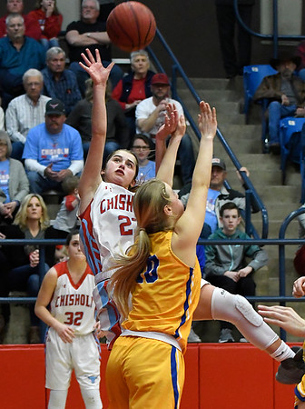 Chisholm's Briley Yunker shoots over against Newkirk's Emiley Elliott during the regional playoffs Friday February 23, 2018 at Chisholm High School. (Billy Hefton / Enid News & Eagle)