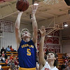 Drummond's Wyatt Gray scores over Kremlin-Hillsdale's Draden Stallings during the first game of the district playoffs Friday February 9, 2018 at Kremlin-Hillsdale High School. (Billy Hefton / Enid News & Eagle)
