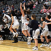 Enid Pacer coach, Gerrett Spears (left), raises his arms as the bench erupts as time expires in the Pacers' 47-46 win over Putnam City Tuesday February 6, 2018 at the Central National bank Center. (Billy Hefton / Enid News & Eagle)