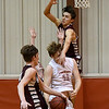 Ringwood's Jeremiah Decker is triple teamed by Garber's Dayne Fuxa, Rodney Phelps and Jake Beebe in a regional tournament game Thursday February 15, 2018 at Ringwood High School. (Billy Hefton / Enid News & Eagle)