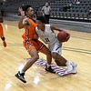 Enid's Darrin Ryan drives towards the basket against Putnam City's Tavy Dawson Tuesday February 6, 2018 at the Central National bank Center. (Billy Hefton / Enid News & Eagle)