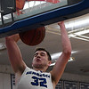 Hennessey's Dalton Vinson finishes a fastbreak with a dunk against Newkirk in the district tournament Friday February 16, 2018 at Hennessey High School. (Billy Hefton / Enid News & Eagle)