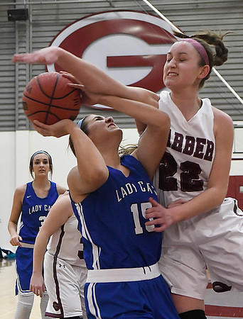 Garber's Jenni Beebe fouls Covington-Douglas' Courtney McDonald Friday February 2, 2018 at Garber High School. (Billy Hefton / Enid News & Eagle)