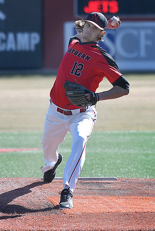 NOC Enid's Kyler Patterson delivers a pitch against Southeast CC Thursday February 8, 2018 at David Allen Memorial Ballpark. (Billy Hefton / Enid News & Eagle)