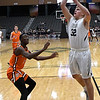 Enid's Baron Winter shoots against Putnam City's Oscar Traylor Tuesday February 6, 2018 at the Central National bank Center. (Billy Hefton / Enid News & Eagle)