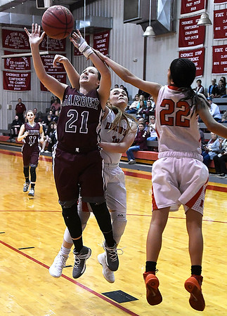 Garber's Mady Swart gets off a shot against Ringwood's Rylee Detrick and Maria Resendiz during an elimination game in the regional tournament Thursday February 15, 2018 at Ringwood High School. (Billy Hefton / Enid News & Eagle)