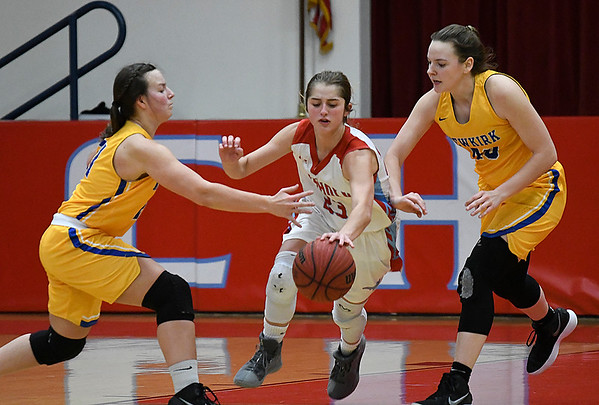 Chisholm's Briley Yunker dribbles between Newkirk's Rylee Lvis and Katelyn Schieber during the regional playoffs Friday February 23, 2018 at Chisholm High School. (Billy Hefton / Enid News & Eagle)