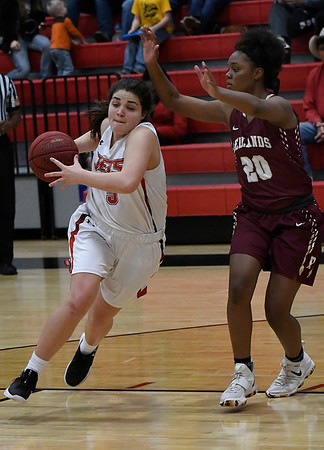 NOC Enid's Addi Meeker drives towards the basket against Redlands' Indya Motte Monday February 12, 2018 at the NOC Mabee Center. (Billy Hefton / Enid News & Eagle)