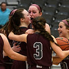 Garber's Macy Swart is surrounded by teammates after making a three point basket as time expired to give the Lady Wolverines a 46-45 win over Texhoma in an elimination game of the area playoffs Friday February 23, 2018 at the Central National Bank Center in Enid. (Billy Hefton / Enid News & Eagle)