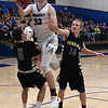 Hennessey's Dalton Vinson goes up for a shot between Newkirk's Colby Case and Carson Vap during the district tournament Friday February 16, 2018 at Hennessey High School. (Billy Hefton / Enid News & Eagle)