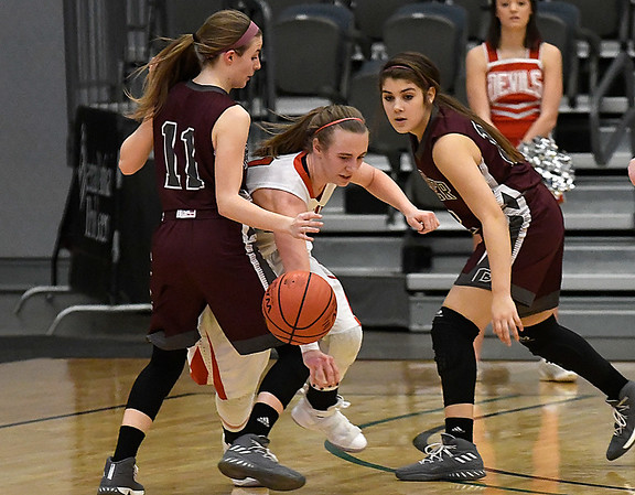 Garber's Paige Frickenschmidt and Bailey Miller trap Texhoma's Tatum Winters during the Lady Wolverines a 46-45 win over Texhoma in an elimination game of the area playoffs Friday February 23, 2018 at the Central National Bank Center in Enid. (Billy Hefton / Enid News & Eagle)
