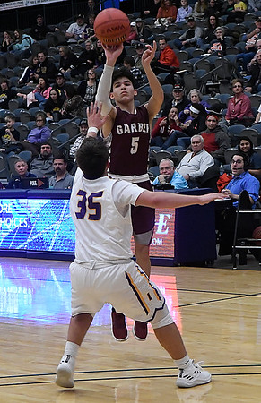 Garber's T.J. Bennett shoots over Laverne's Dane Duvall during an elimination game of the area playoffs Friday February 23, 2018 at the Central National Bank Center in Enid. (Billy Hefton / Enid News & Eagle)