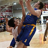 Drummond's Jake Isabell scores over Kremlin-Hillsdale's Cody Bower during the first game of the district playoffs Friday February 9, 2018 at Kremlin-Hillsdale High School. (Billy Hefton / Enid News & Eagle)