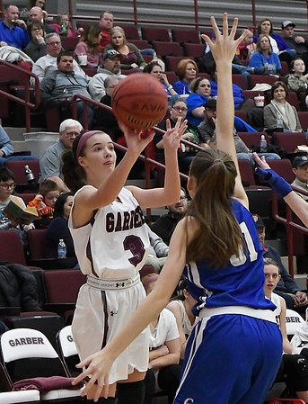 Garber'sKathryn Plunkett shoots over Covington-Douglas' Sunnie May Friday February 2, 2018 at Garber High School. (Billy Hefton / Enid News & Eagle)