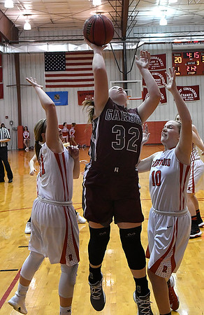 Garber's Macy Swart puts up a shot between Ringwood's Kynsie Wallace and Rylee Detrick during an elimination game in the regional tournament Thursday February 15, 2018 at Ringwood High School. (Billy Hefton / Enid News & Eagle)