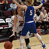 Garber's Mady Swart tries to drive around Covington-Douglas' Abby Buller Friday February 2, 2018 at Garber High School. (Billy Hefton / Enid News & Eagle)