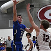 Covington-Douglas' Gavin Smith shoots over Garber's Dayne Fuxa Friday February 2, 2018 at Garber High School. (Billy Hefton / Enid News & Eagle)