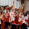 Members of the Ringwood High School boys basketball teams cheers a made three point shot by the Lady Red Devils during an elimination game in the regional tournament Thursday February 15, 2018 at Ringwood High School. (Billy Hefton / Enid News & Eagle)