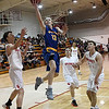 Drummond's Seth Gray drives to the basket for a layup between Kremlin-Hillsdale's Cody Bower, Dakota Gabriel and Draden Stallings during the first game of the district playoffs Friday February 9, 2018 at Kremlin-Hillsdale High School. (Billy Hefton / Enid News & Eagle)