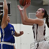 Garber's Jenni Beebe shoots against Covington-Douglas' Courtney McDonald Friday February 2, 2018 at Garber High School. (Billy Hefton / Enid News & Eagle)