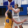 Hennessey's Morgan Wymore shoots over Newkirk's Rylee Lvis during the district tournament Friday February 16, 2018 at Hennessey High School. (Billy Hefton / Enid News & Eagle)
