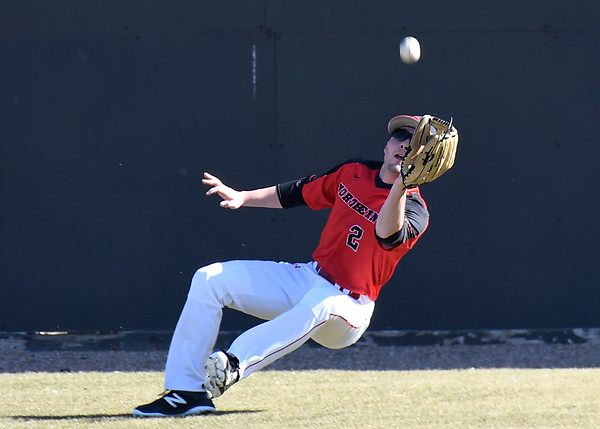NOC Enid's Clayton Peterson falls as he makes a catch in deep centerfield against Southeast CC Thursday February 8, 2018 at David Allen Memorial Ballpark. (Billy Hefton / Enid News & Eagle)